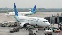 Pesawat Garuda Indonesia tunda sementara penerbangan dari dan menuju China dikarenakan Virus Corona. (Foto: Adek Berry/AFP)