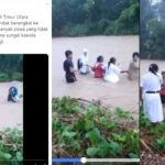 Aksi seorang guru dan murid menyebrangi sungai tanpa memakai perlengkapan apa apa.
