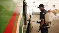 Petugas PT KAI Melakukan Penyemprotan Disinfektan di Kereta Barang