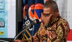 Achmad Yurianto memberikan keterangan pers di Gedung BNPB. (Foto: Antara)