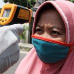 Ilustrasi penggunaan masker kain. (Foto: Jawapos)