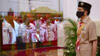 Presiden Joko Widodo memimpin upacara Peringatan Hari Pramuka ke-59 Tahun 2020 secara konferensi video dari Istana Negara